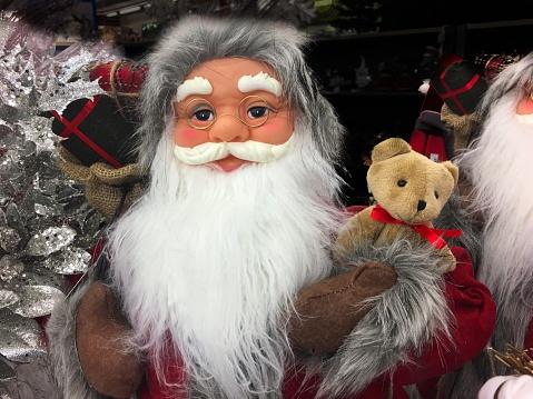 Beard「Portrait of a Santa Claus puppet in a store holding a teddy bear」:スマホ壁紙(4)