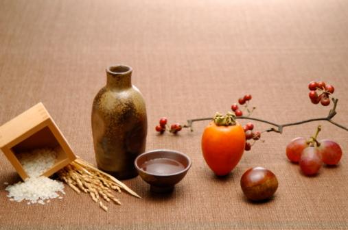 Sake「Sake, rice and fruits on brown background」:スマホ壁紙(9)