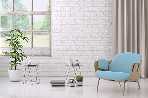 Brick Wall「blue colored armchair with coffee table, flowers and blank wall template」:スマホ壁紙(8)