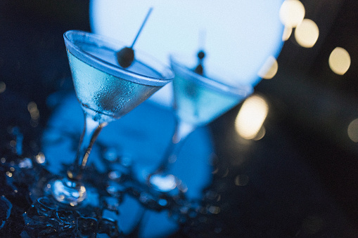 Bahamas「Outdoors night shot of two martinis with olives, as shot in Nassau.」:スマホ壁紙(14)