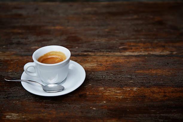 Espresso coffee on a rustic cafe' table:スマホ壁紙(壁紙.com)