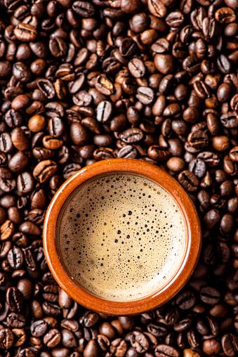 Coffee - Drink「Espresso coffee mug over coffee beans」:スマホ壁紙(2)