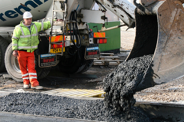 Cement「Cement is poured inbetween the new rail's of Blackpool's Tram Track, during  replacement works, which has seen the line upgraded in order to carry brand new 'light rail' trams in the future.」:写真・画像(10)[壁紙.com]