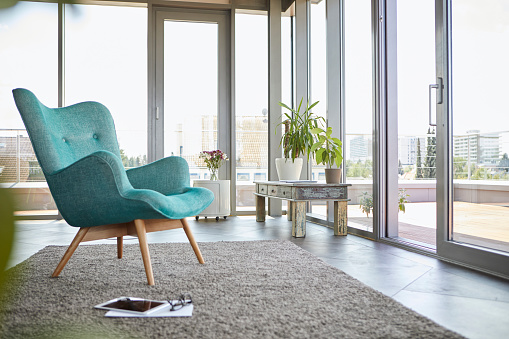 Chair「Home interior with armchair, tablet and view on roof terrace」:スマホ壁紙(12)