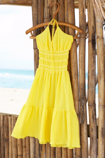 Yellow Dress「Yellow dress on wooden hanger in bamboo hut」:スマホ壁紙(1)