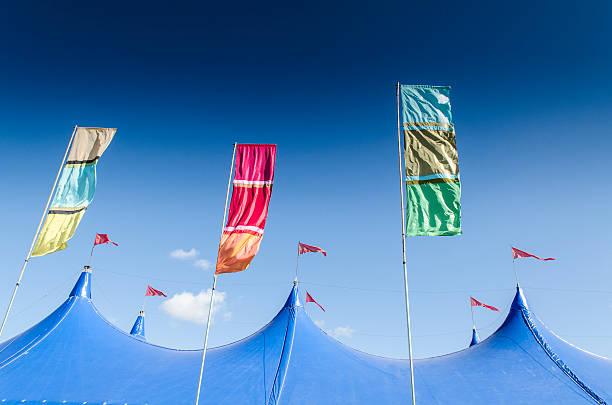 Festival tent top and coloured flags:スマホ壁紙(壁紙.com)
