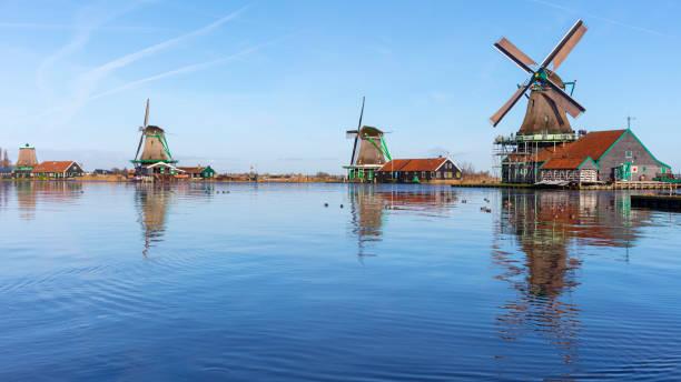 Traditional Dutch windmills at Zaanse Schans, Amsterdam, Netherland:スマホ壁紙(壁紙.com)