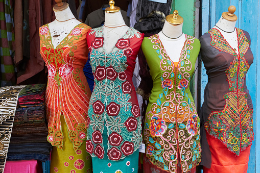 Embroidery「Traditional sarongs on mannequins at market」:スマホ壁紙(18)