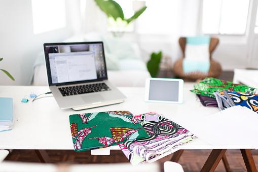 Small Office「Traditional fabrics on fashion designers desk in home studio」:スマホ壁紙(11)