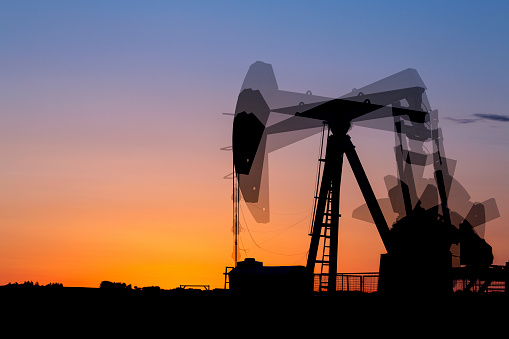 Tentacle Sucker「Multi exposure of a pumpjack silhouetted at sunrise with a glowing warm sky, West of Airdrie」:スマホ壁紙(7)