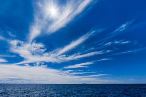 Spirituality「Sun and cirrus over sea, distant island」:スマホ壁紙(10)