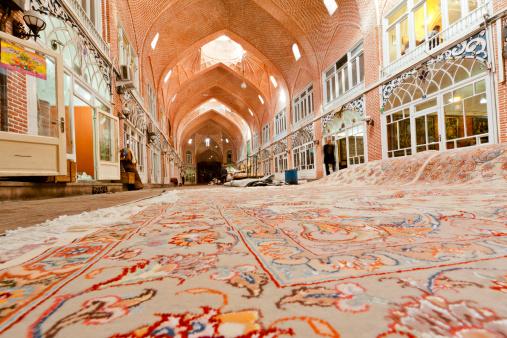 Iran「Huge silk carpets lying across floor outside stalls in carpet bazaar.」:スマホ壁紙(4)