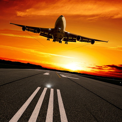 Approaching「XXL jumbo jet airplane landing at sunset」:スマホ壁紙(10)