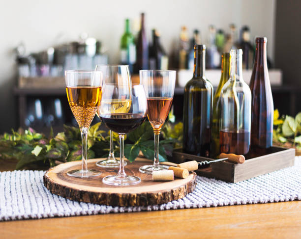 Wine tasting theme with various bottles of wine and glasses:スマホ壁紙(壁紙.com)