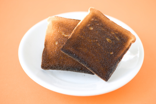 Ruined「Two slices of burned toast on plate, close-up, elevated view」:スマホ壁紙(2)