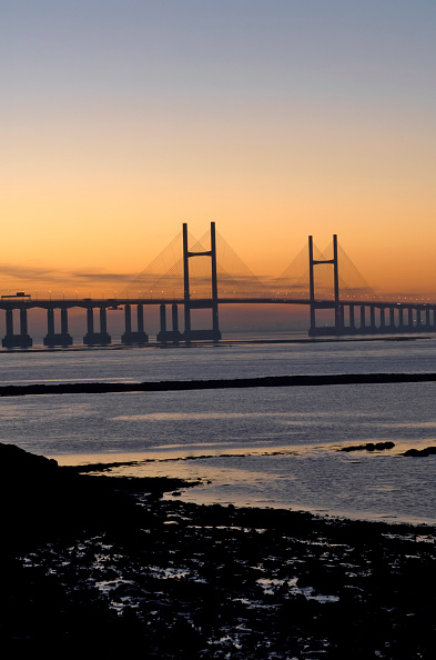 Dawn「M4 Motorway to Wales across Second Severn Crossing Bridge River Severn Estuary Gloucestershire UK. This bridge is the 'new' M4 Second Severn Crossing. The new Crossing was opened on 5th June 1996 by His Royal Highness, The Prince of Wales.」:写真・画像(19)[壁紙.com]