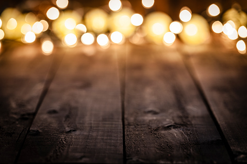Celebration「Empty rustic wooden table with blurred Christmas lights at background」:スマホ壁紙(12)