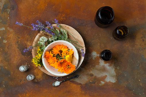Marigold「Blossoms of medical plants, medicine flasks and globules on rusty ground」:スマホ壁紙(16)
