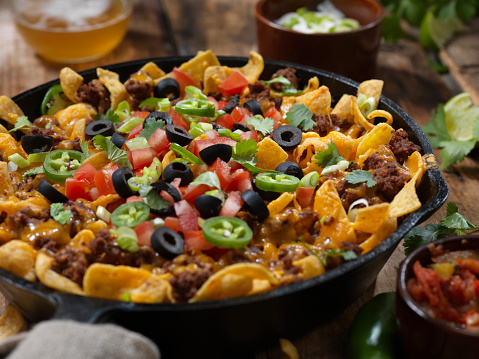 Crunchy「Baked Frito Pie (Chili Corn Chip Nachos) with Black Olives, Tomatoes, Green Onions, Jalapenos, Salsa, Guacamole and Sour Cream」:スマホ壁紙(1)