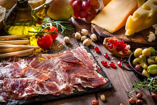 Serrano Ham「Delicious Iberico ham tray shot on rustic wooden table」:スマホ壁紙(15)