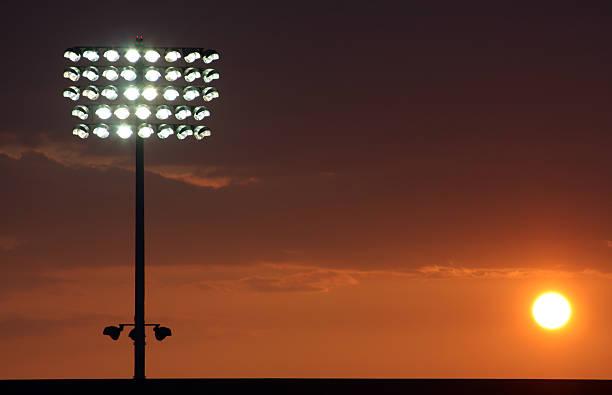 Football stadium lights at sunset:スマホ壁紙(壁紙.com)