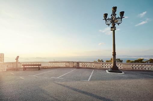 Parking Lot「Empty carpark with direct sun light overlooking the sea」:スマホ壁紙(10)
