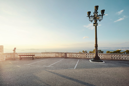 France「Empty carpark with direct sun light overlooking the sea」:スマホ壁紙(12)