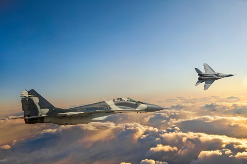 Russian Military「Mig-29 Fighter Jets in Flight over the clouds at sunset」:スマホ壁紙(0)