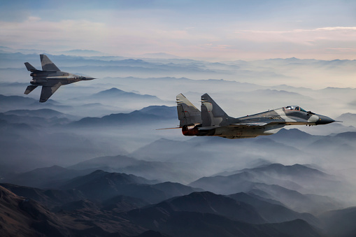 Fighter Plane「Mig-29 Fighter Jets in Flight above the fogy mountains」:スマホ壁紙(4)
