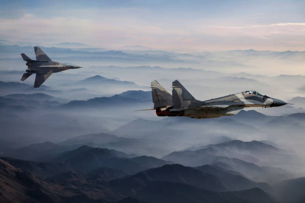Mig-29 Fighter Jets in Flight above the fogy mountains:スマホ壁紙(壁紙.com)