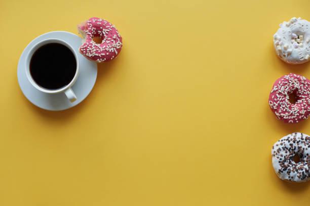 Four sprinkled donut and cup of coffee. Debica, Poland :スマホ壁紙(壁紙.com)