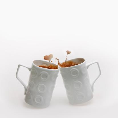 Coffee Break「Two mugs clinked together form heart shaped splash」:スマホ壁紙(18)