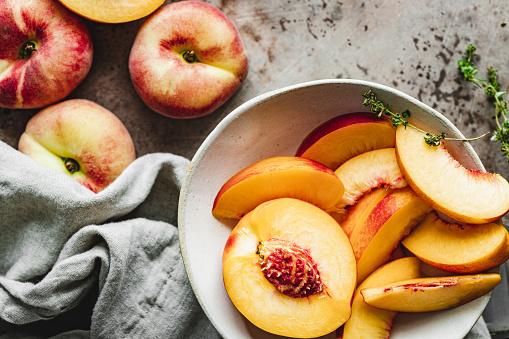 Peach「Slices of ripe peaches in a bowl.」:スマホ壁紙(15)