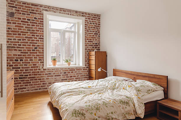 Bedroom in modern building with brick wall:スマホ壁紙(壁紙.com)