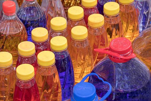 Market Stall「Rows of transparent liquid  detergent bottles at Hasircilar street, Eminonu Istanbul Turkey」:スマホ壁紙(8)