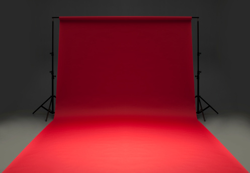 Behind The Scenes「Seamless red background paper hanging on stands-isolated on grey」:スマホ壁紙(10)