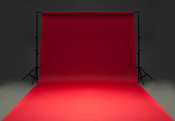 Seamless red background paper hanging on stands-isolated on grey:スマホ壁紙(壁紙.com)