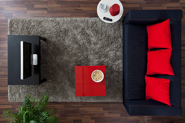 A sofa, TV and side table with a bowl of popcorn, overhead view:スマホ壁紙(壁紙.com)