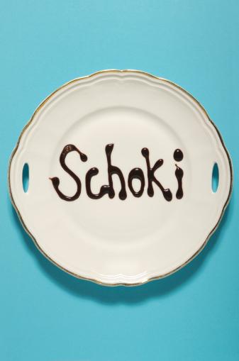 チョコレート「Text form with chocolate sauce on plate」:スマホ壁紙(18)
