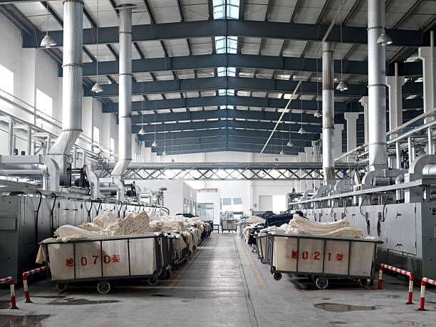 Bins of fabric lined up for dying at a factory.:スマホ壁紙(壁紙.com)