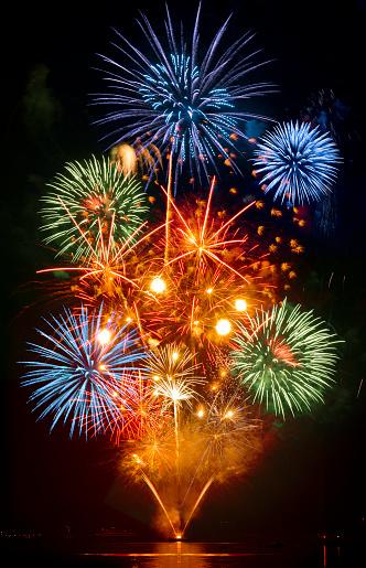 Fourth of July「Fireworks exploding over cruise ship in harbor, Seattle, Washington, United States」:スマホ壁紙(6)
