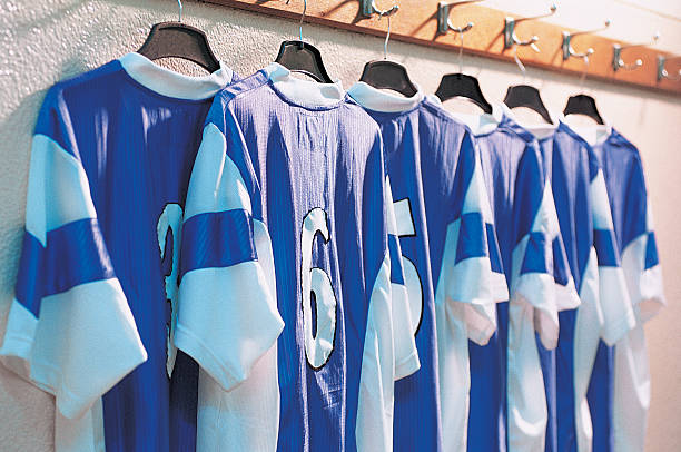 Line Of Rugby Shirts Hanging From Clothes Rail:スマホ壁紙(壁紙.com)