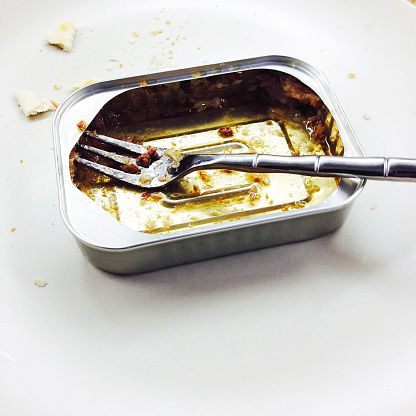 Fork「Empty sardine can and a small fork with saltine cracker crumbs around it」:スマホ壁紙(2)