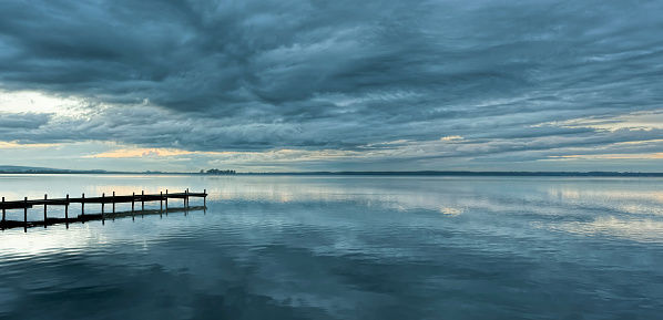 Perfection「Dramatic cloudscape and jetty at dusk with reflection on lake」:スマホ壁紙(0)