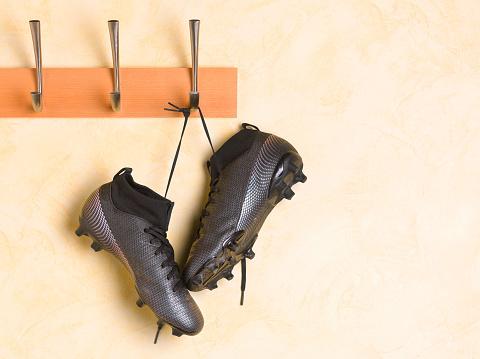 Club Soccer「Soccer boots hanging up in locker room」:スマホ壁紙(12)