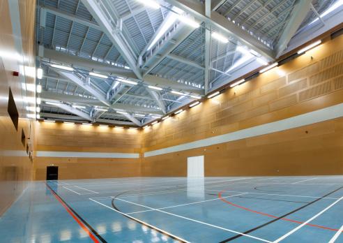 Illuminated「Interior of school gym with blue flooring」:スマホ壁紙(8)