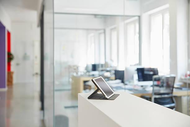 Interior of bright modern office with digital tablet on ledger:スマホ壁紙(壁紙.com)
