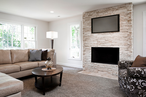 Midwest USA「Interior of elegant living room with fireplace」:スマホ壁紙(10)