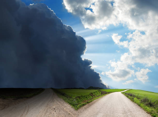 Forked road in countryside landscape over stormy and sunny sky:スマホ壁紙(壁紙.com)