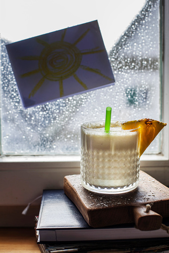 Bixby Creek Bridge「Glass of Pina Colada standing in front of window covered in raindrops」:スマホ壁紙(3)